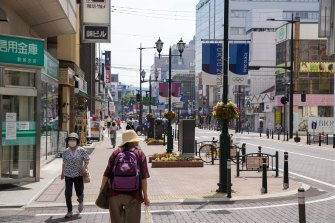 Fukushima's main street on Wednesday as the Japanese softball team opens the Olympics.