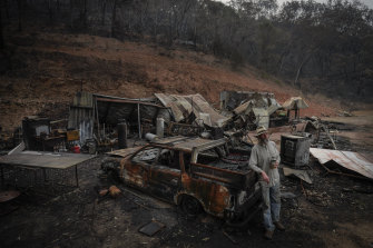 Mark Brooks at the wreckage of his house in the Upper Towgla valley.