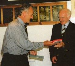 Ted Dexter makes a presentation to David Buckingham.