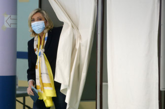 Far-right leader Marine Le Pen leaves the voting booth.