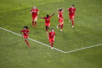 The Canadians celebrate their goal.