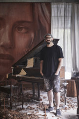 Melbourne street artist Rone inside his exhibition at Burnham Beeches.