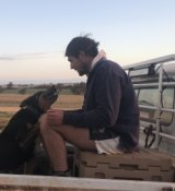 Lachlan Dewar at home on Woodyarrup merino stud with his dog, Sid.