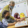 Primary school students wear masks in class at a school in Oakland, California.