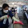 Disinfection spraying anti-septic solution at Seoul's Incheon Airport.  The coronavirus outbreak has dented travel demand in the Asia Pacific.