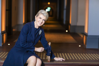 Julie Bishop with her Barbie doll, whose outfit is modelled on her dress from the day she quit politics.