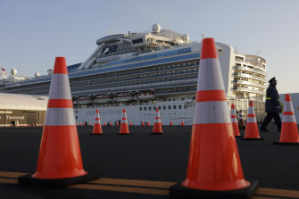 A security guard stands near the quarantined Diamond Princess cruise ship.