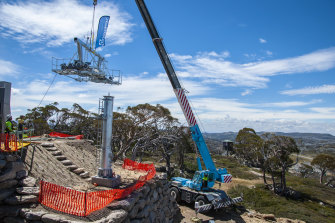 One of the new ski lift towers at Perisher being installed by crane.