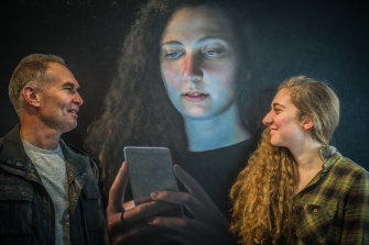 Ross Townsend with his daughter Hannah and his portrait of her which was a finalist in the Douglas Moran National portrait prize in 2017.