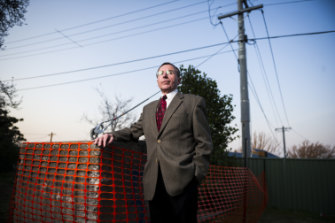 Leo Dobes of the Griffith Narrabundah Community Council with the concrete pillar.