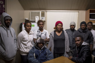Tulia Roqara, centre, at a meeting in her caravan with other workers from Vanuatu.