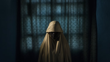 Aisha, 15, was kidnapped by Boko Haram and subsequently refused to carry out a suicide bombing, in Maiduguri, Nigeria, last year.