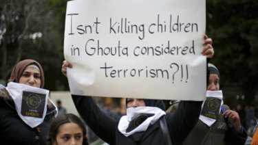 A Lebanese woman protests the assault on Ghouta.