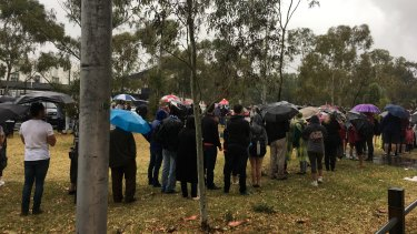 Diehard fans queued in the torrential rain for the AFLW grand final.