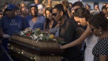Marielle Franco's relatives grieve during her burial in Rio de Janeiro, Brazil,