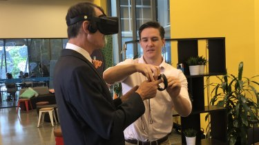 Brisbane's Lord Mayor Graham Quirk and Equal Reality co-founder Rick Martin using virtual reality.