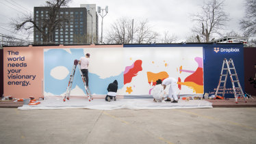 Artists work on a live mural titled 'Activism Through Art'  during the South By Southwest (SXSW) conference on Friday.