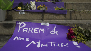 """A sign with a message that reads in Portuguese: """"Stop Killing Us!"""" makes up part of a makeshift memorial for Franco."""