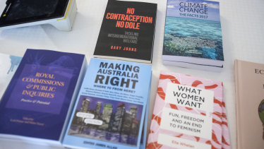 Reading material for sale at Senator Malcolm Roberts' cost-of-living summit in Brisbane.