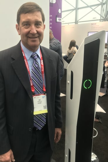 Cosy COO Ed Henkler with a shelf-scanning robot.
