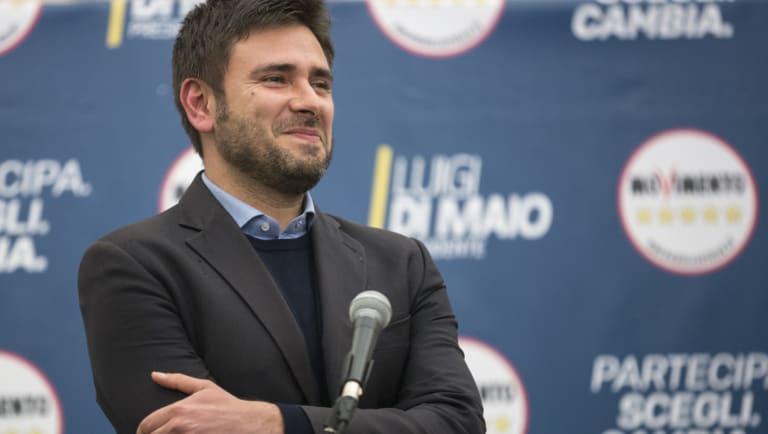 Alessandro Di Battista, of Italy's anti-establishment Five Star Movementr, pauses while delivering a speech at the Five Star electoral centre in Rome, Italy, on Monday.