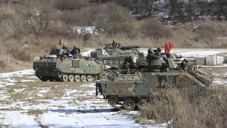 South Korean army vehicles undertake a military exercise near the North Korean border.