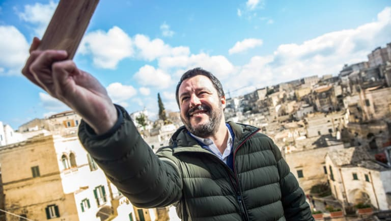 Matteo Salvini, leader of the anti-migrant and eurosceptic party, The League, takes a selfie on the campaign trail.