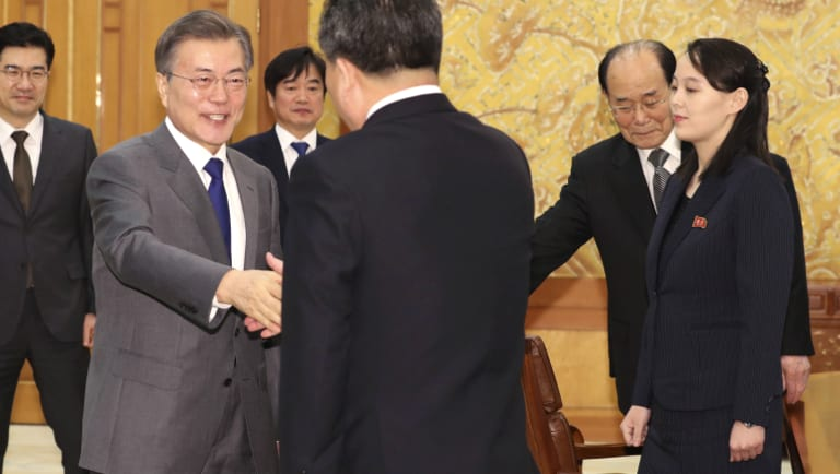 South Korean President Moon Jae-in (left) shakes hands with North Korean official Ri Son-gwon as Kim Jong-un's sister Kim Yo-jong (right) looks on at a February meeting. The two Koreas have held unprecedented diplomatic talks.