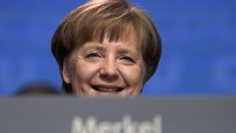 German Chancellor  Angela Merkel smiles at the party convention of the Christian Democratic Union CDU in Berlin.