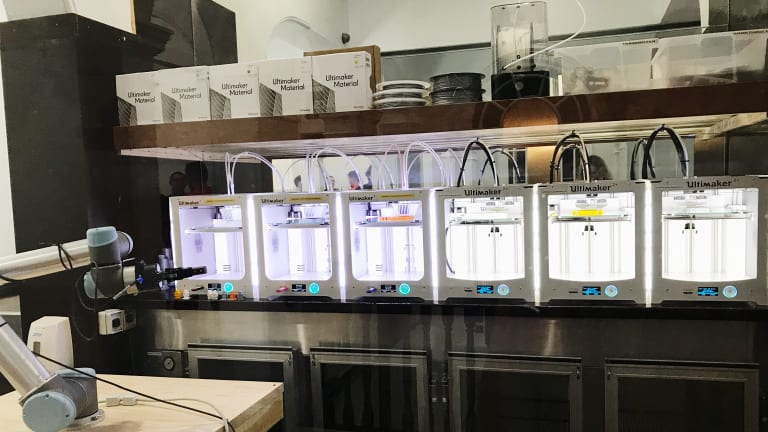 3D printers at work inside the Arc hub in Fortitude Valley.