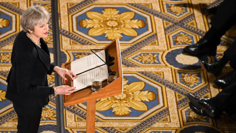 British PM Theresa May delivers her speech at Mansion House in London.