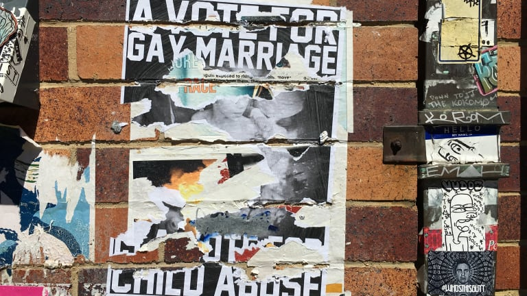 Homophobic posters have appeared in West End, Brisbane ahead of the marriage postal vote.