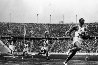 Jesse Owens breaking down social barriers at the 1936 Olympics.