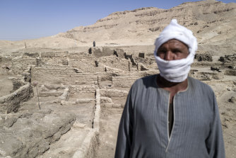 "A worker at the site of a 3000-year-old lost city in Luxor, Egypt. Egyptian archaeologists have discovered Aten or ""the lost golden city"" which is believed to be the largest ancient city ever discovered in Egypt."