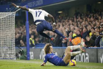 Tottenham's Moussa Sissoko (top) challenges Chelsea's David Luiz.