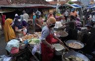 Shoppers at a fried food stall at Karangayu Market in Semarang, Central Java.