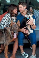 Priyanka at home with her husband Nick and their three dogs, Diana, Gino and Panda.