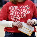 A local resident holds a presidential preference card during a Democratic Party caucus in Iowa.