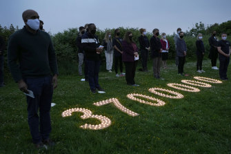 Campaigners attend a vigil in Falmouth, Cornwall, near the G7 summit in Carbis Bay, to remember the millions who have already died during the pandemic.