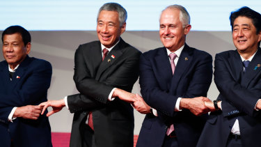 Singapore Prime Minister Lee Hsien Loong, second from left, with Malcolm Turnbull and other leaders at the 2017 East Asia Summit.