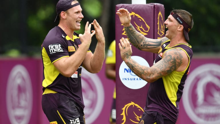 Celebration: Matt Lodge is congratulated by teammate Josh McGuire at Broncos training.