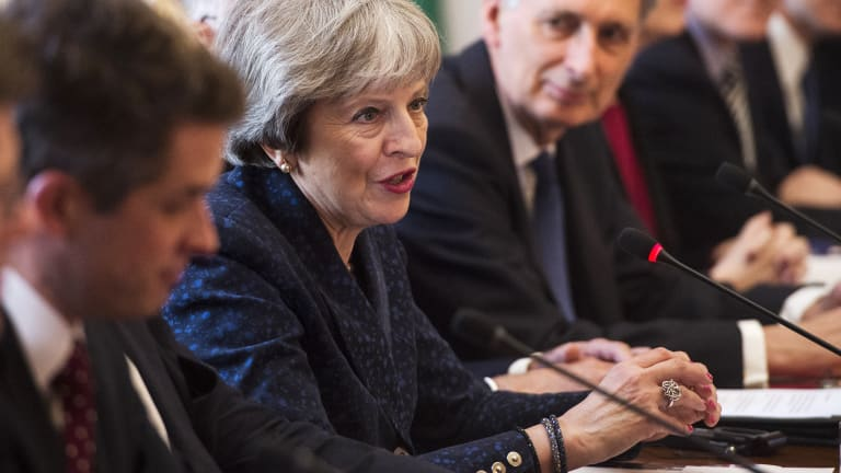 Prime Minister Theresa May, centre, avoided blaming Russia, for now.