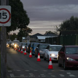 Long queues for the 24-hour COVID testing drive through clinic at Fairfield West, in Sydney.