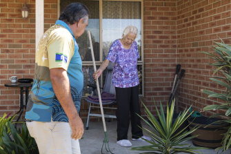 Booraja project manager Bunja Smith helps Veronica Holmes tidy the front yard of her Moruya home.