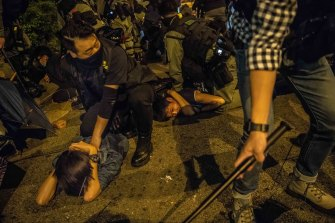 Police detain protesters attempting to escape from a police siege on the Poyltech University campus in Hong Kong this week.