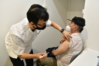 Chieu Lim, 81, receives a vaccine at Cabramatta in Sydney's west.