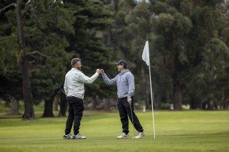 David McCartney [left] and Dene Heath were among those who hit Albert Park Golf Course on Wednesday morning.