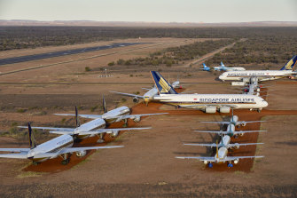 Aircraft emissions have dived as aeroplanes have been grounded all over the world. Pictured here are planes at a storage facility in Alice Springs.