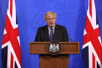 British Prime Minister Boris Johnson postpones the easing of England's remaining COVID-19 restrictions.