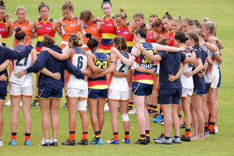 Players from both sides pause to remember former Giant Jacinda Barclay during a pre-season match between the Crows and GWS Giants earlier this month.